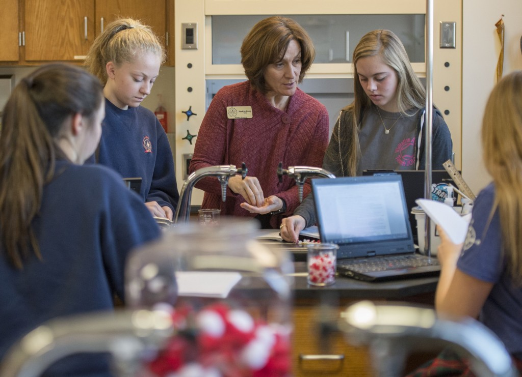 Heather Essig leads a high school science experiment