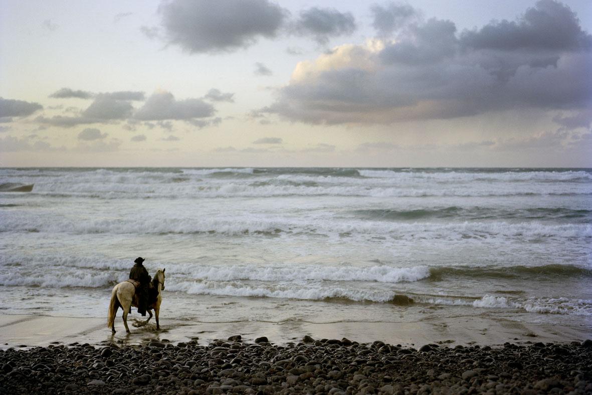 Cowboy by the sea