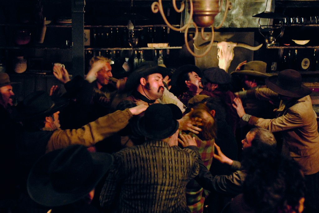 Men fighting in saloon