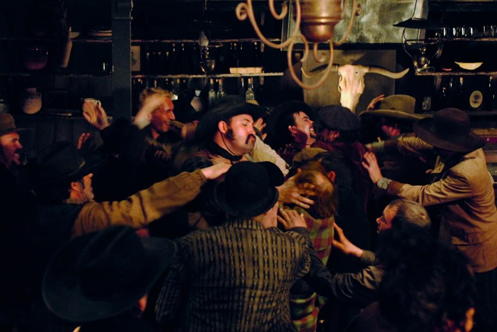 Men fighting in saloon