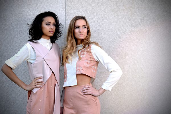 Sheridan Young (left) and Maggie Hennessey of Centro Models wear designs by senior Priyanka Reddy. (Photo: James Byard/Washington University)