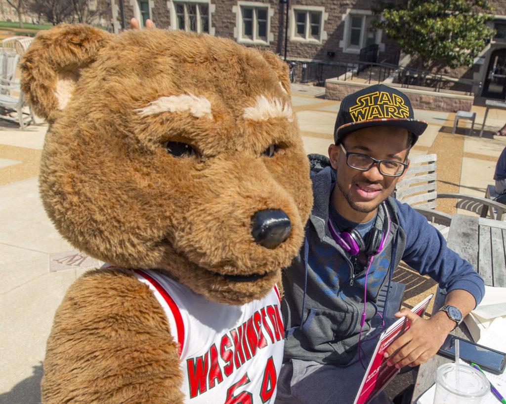 Wash U Bear meets a student