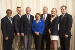 (From left:) Mahendra Gupta; Christopher Hoffmann, MBA '16, vice president of Olin Family Business Club; Roger Koch; Elke Koch; Paul Koch; Emmy Caton, MBA '17 and incoming club president; and Ryan Plotkin, MBA '16 and president. (Photo: Whitney Curtis/Washington University)