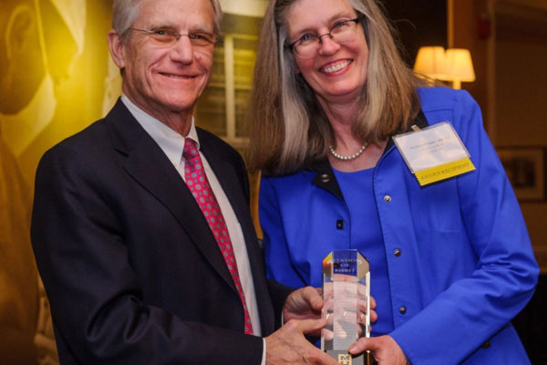 Patrice Delafontaine, MD, dean of the University of Missouri School of Medicine, presents Victoria J. Fraser, MD, head of the Department of Medicine at Washington University, with the Citation of Merit from the University of Missouri. (Photo: University of Missouri)