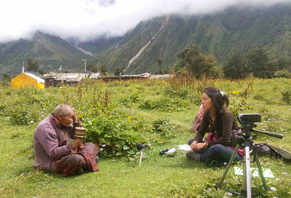Jhangchuk Sangmo, a researcher from the Nubri region of Nepal, interviews an elderly nun about the aftermath of a 2015 earthquake.