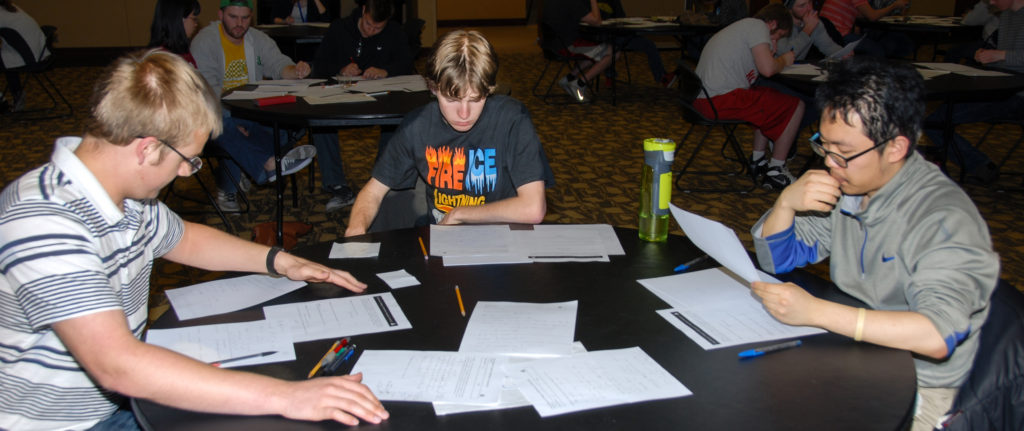 Matt Ehren, Alex Mason and Harry Go working on problems at the 21st Annual Missouri Collegiate Mathematics Competition. They scored a perfect 100 to tie with a team from Missouri Southern State for first place. (Photo: Hang Chen)