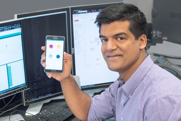 Student with app showing on phone