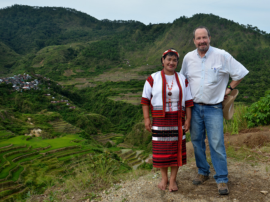 Washington University anthropologist Glenn Stone, shown here with an agricultural field agent, has studied rice cultivation and research in the Philippines since 2013.