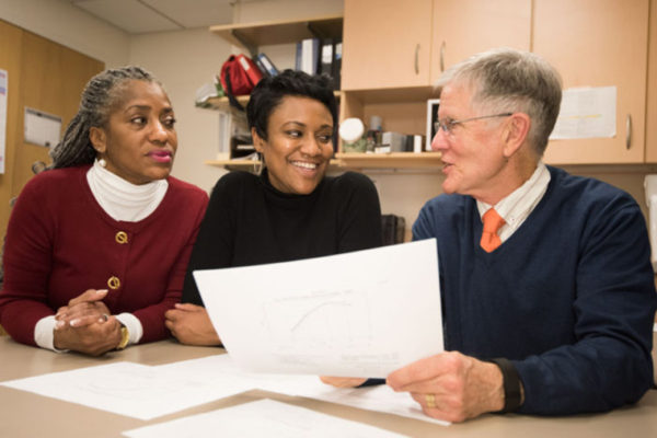 Robert Boston  Robert C. Strunk, MD, (right) discusses results of a decades-long pediatric asthma study that involved Janae Smith, (middle) a patient and study participant, and Denise Rodgers, (left) who retired earlier this year as a clinical research coordinator. The findings emphasize that lifelong attention may be needed to prevent worsening lung function. Strunk, a renowned pediatric allergist, died of cardiac arrest April 28, before the new study's publication May 12 in The New England Journal of Medicine.  (Photo: Robert Boston/School of Medicine)