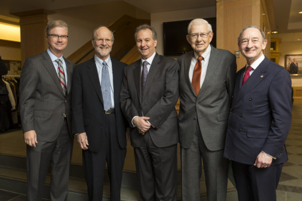 Aaron F. Bobick (center), dean of the School of Engineering & Applied Science, was installed as the James M. McKelvey Professor  Jan. 21. Helping him celebrate were (from left) Provost Holden Thorp, John McDonnell,  James McKelvey and Chancellor Mark S. Wrighton.