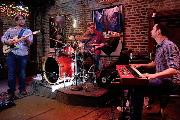 The Liberation Organ Trio. From left to right are guitarist Tim Fischer, drummer Kyle Honeycutt and keyboardist Nathan Jatcko.