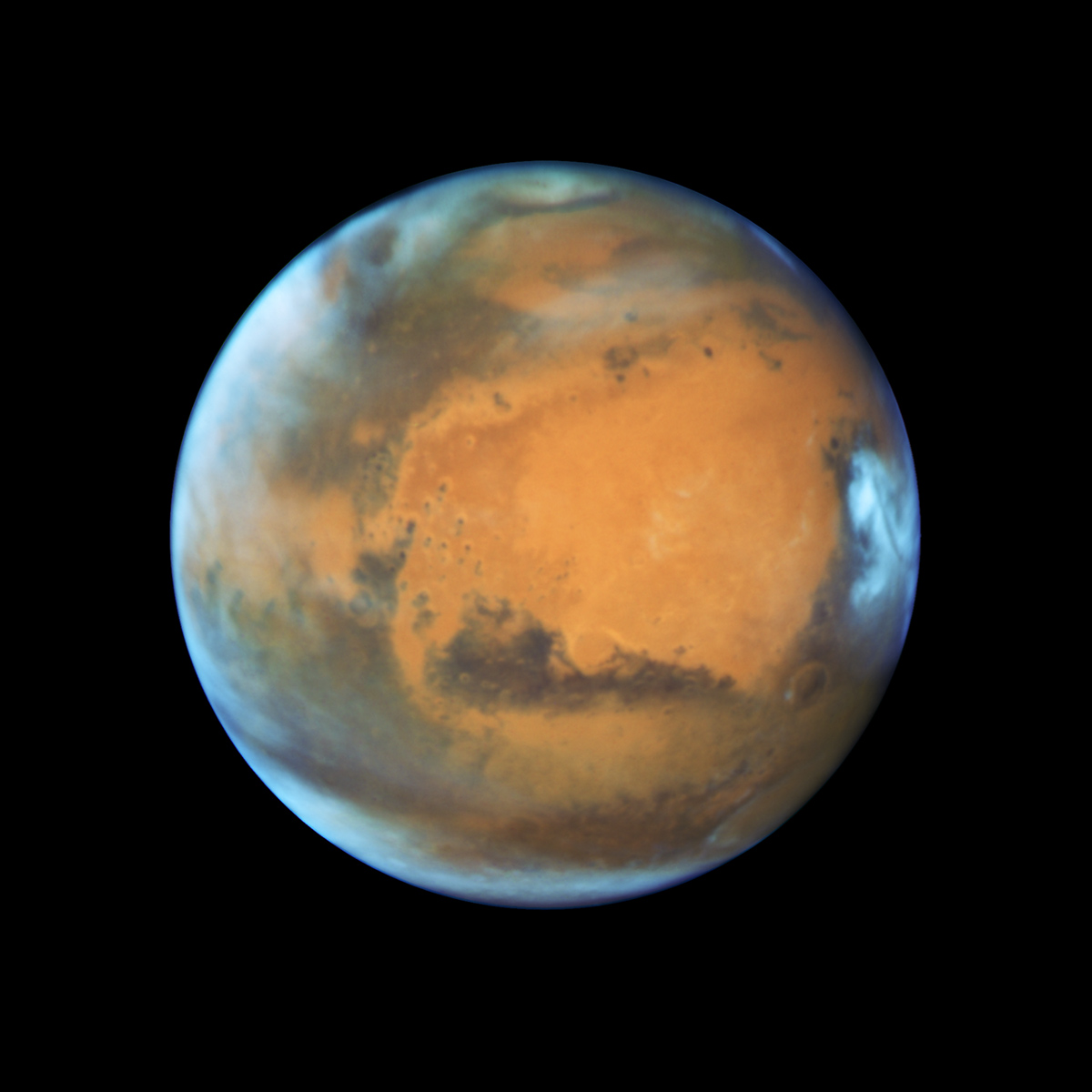 Bright, frosty polar caps, and clouds above a vivid, rust-colored landscape reveal Mars as a dynamic seasonal planet in this NASA Hubble Space Telescope view taken on May 12, 2016, when Mars was 50 million miles from Earth.An extended blanket of clouds can be seen over the southern polar cap. The icy northern polar cap has receded to a comparatively small size because it is now late summer in the northern hemisphere.Credit: NASA, ESA, the Hubble Heritage Team (STScI/AURA), J. Bell (ASU), and M. Wolff (Space Science Institute)