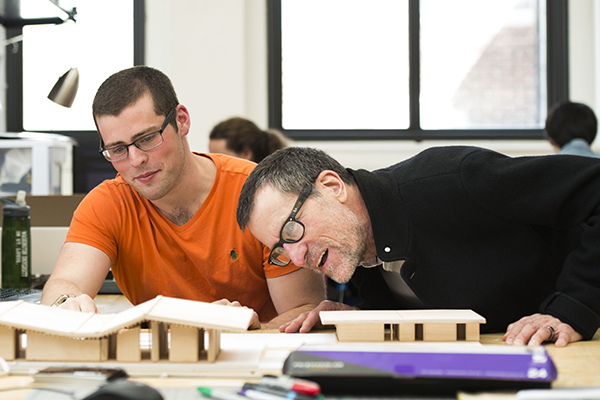 Bruce Lindsey, dean of the College of Architecture and Graduate School of Architecture & Urban Design, works with students in Givens Hall. (Photo: Joe Angeles/Washington University)