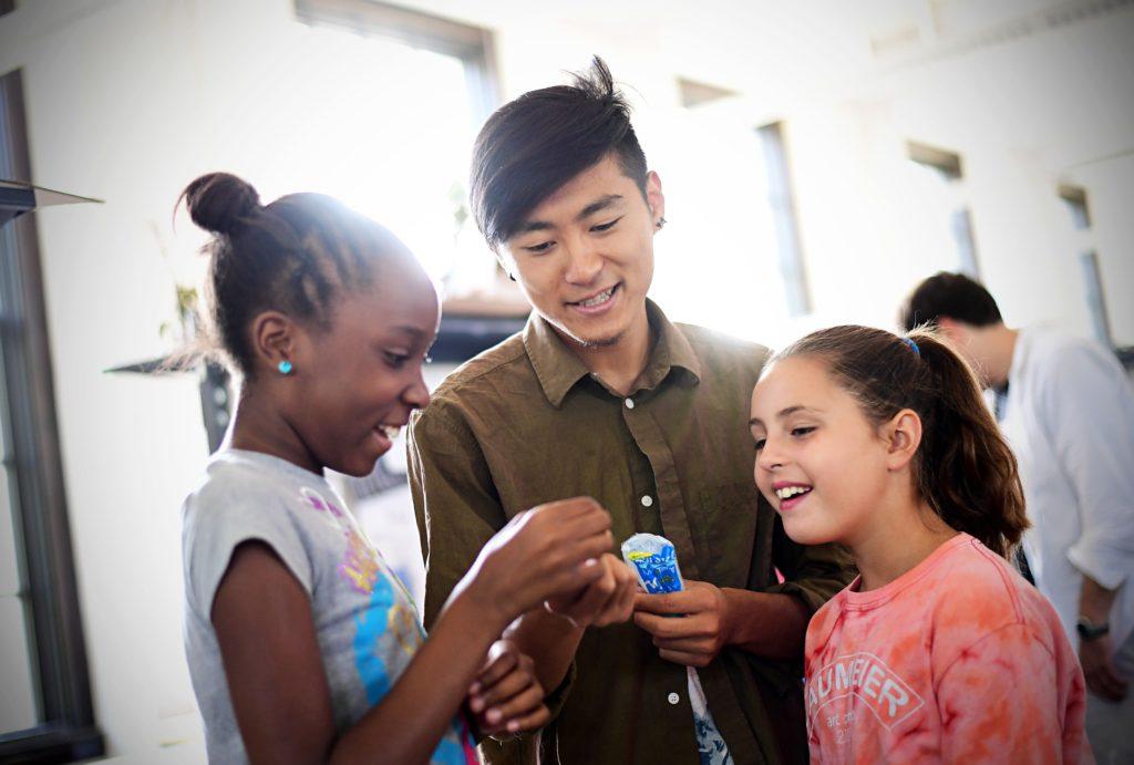 Recent graduate Jun Bae (center) works with students in the Sam Fox School's Alberti Program last June. (Photo: James Byard/Washington University)