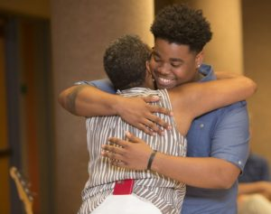 Marquise Butcher of Central Visual and Performing Arts High School says goodbye with a hug for Leah Merrifield, creator of the College Prep program. (Photo: Jerry Naunheim Jr./Washington University)