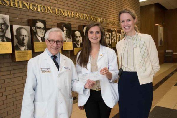 medical student smiles at earning fellowship
