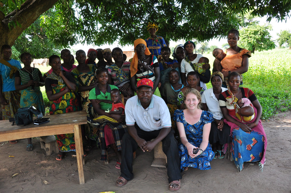 women in Tanzania pose for a photo with Adrienne Strong