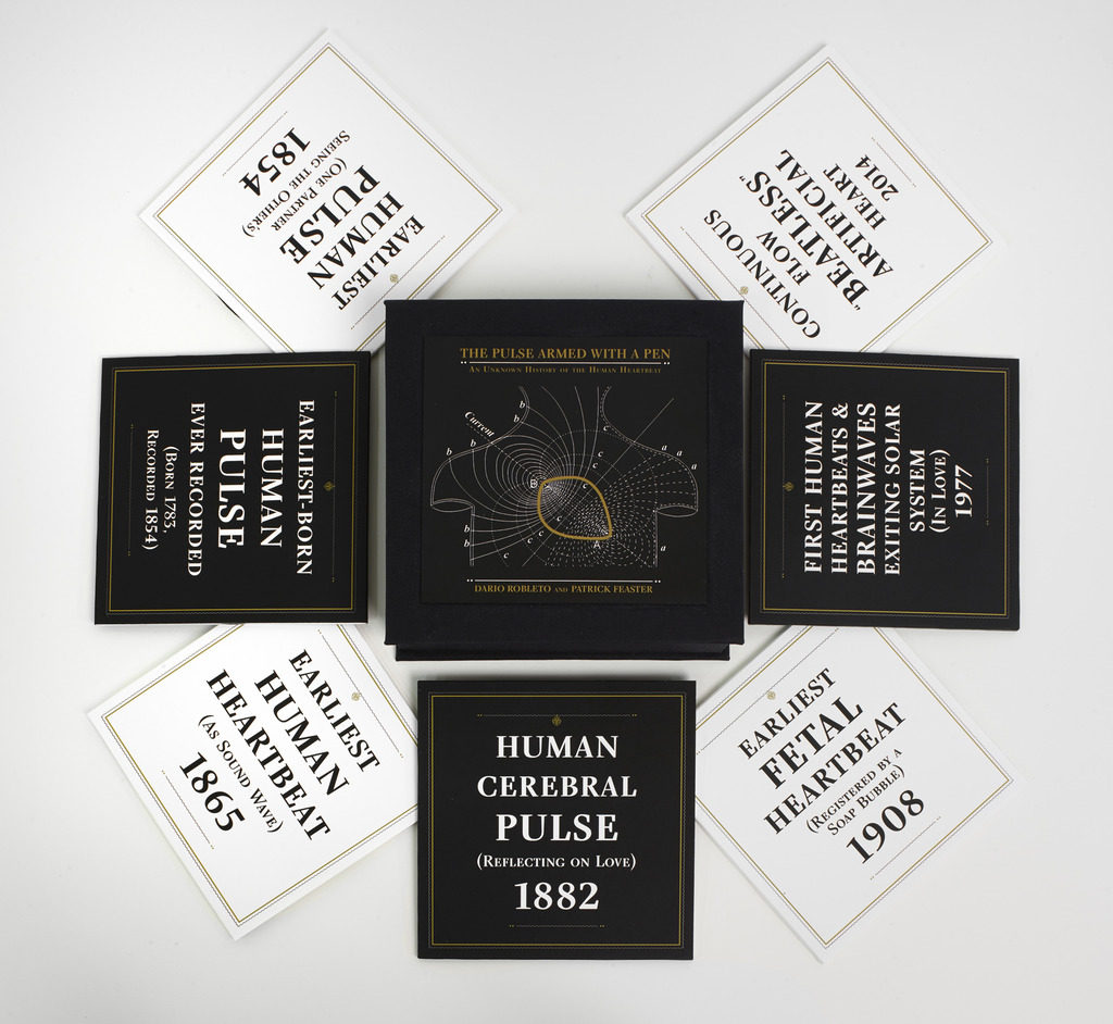 """Dario Robleto, """"The Pulse Armed With a Pen (An Unknown History of the Human Heartbeat) mini box version,"""" 2014. 7 custom cut 5-inch vinyl records, audio recordings, archival digital prints (record sleeves, liner notes, labels, slides), headphones, media player."""