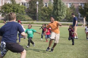 SATURDAY, SEPT. 24, 2016 - Washington University student Ilan Wallentin (left), a member of the Alpha Epsilon Pi fraternity, horses around with Camden Butler, 5, during Greek Day of Service, now an annual tradition, that hosts dozens of KIPP families on the Washington University campus. Young KIPPsters and their parents toured campus and participated in activities. The program gives young students a look at college life. Photo by Jerry Naunheim Jr./WUSTL Photoss