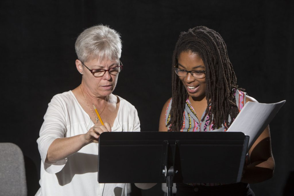 Berry works with director Annamarie Pileggi, professor of the practice in drama. (Photo: Jerry Naunheim/Washington University)