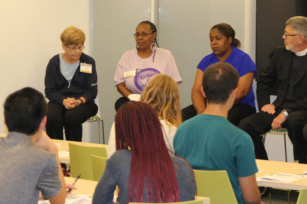Community members affected by gun violence in St. Louis speak with Washington University students taking part in a recent Public Health Challenge. Pictured, from left, are Linda Fehrmann, of American Foundation for Suicide Prevention; Valerie Dent, of STL Mothers in Charge; Glenda Lay, a survivor, and the Rev. Marc Smith, vicar of gun violence for the Episcopal Diocese of Missouri. (Photo: Institute for Public Health)