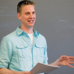"""Abram Van Engen, associate professor of English and affiliated faculty member with the Danforth Center on Religion and Politics, teaches undergraduates in his course """"City on a Hill: The Concept and Culture of American Exceptionalism."""" (Sid Hastings/WUSTL Photos)"""