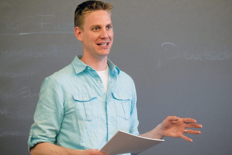 "Abram Van Engen, associate professor of English and affiliated faculty member with the Danforth Center on Religion and Politics, teaches undergraduates in his course ""City on a Hill: The Concept and Culture of American Exceptionalism."" (Sid Hastings/WUSTL Photos)"