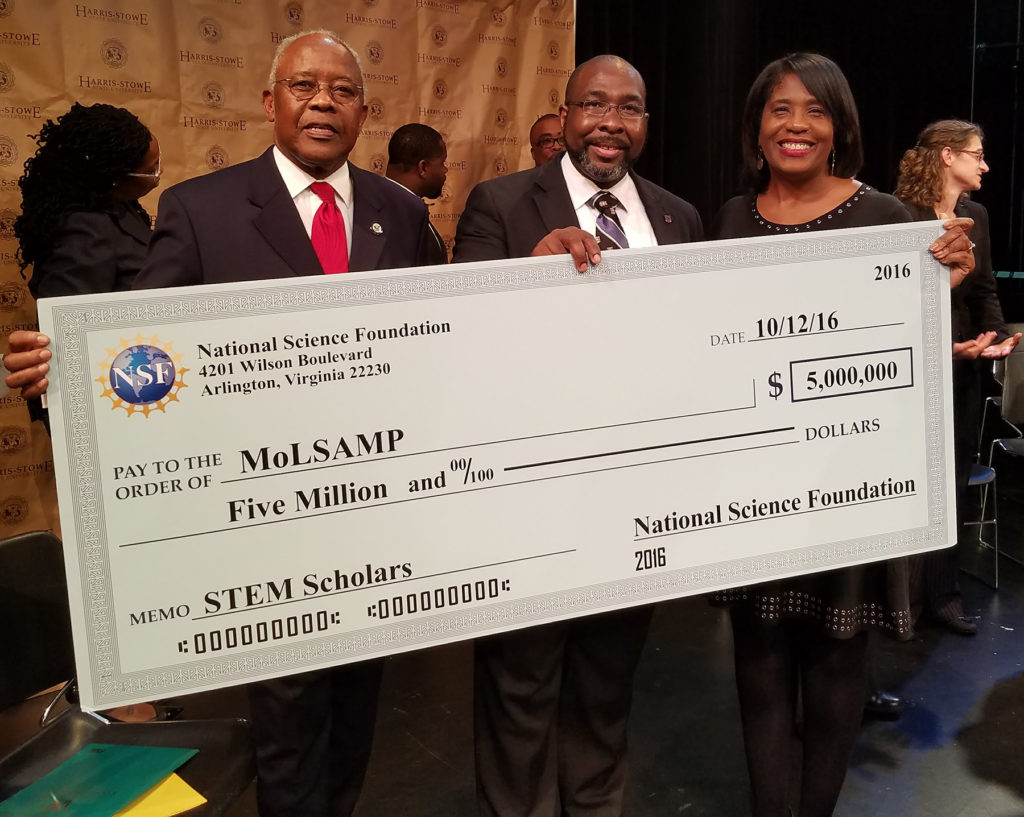 Washington University's Rochelle Smith (right) and Dedric Carter (center) help Art Hicks of the NSF's Louis Stokes Alliances for Minority Participation program announce the LSAMP grant Oct. 12 at Harris Stowe State University.