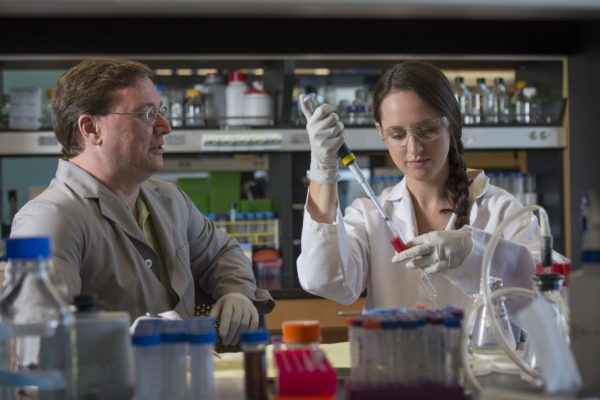7.8.2014--Professor Joe Jez working in his lab with a student. Ashley Muehler-Sherp, Graduate Student in Plant Biology. Photo by Joe Angeles/WUSTL Photos
