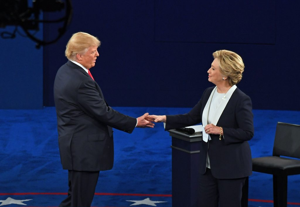 Presidential candidates Donald Trump and Hillary Clinton participate in a town hall meeting during the 2016 Presidential Debate at Washington University in St. Louis Sunday, Oct. 9, 2016. (Photo: James Byard/Washington University)