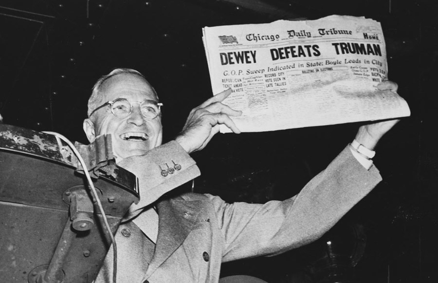 "Harry S. Truman holding up the newspaper ""Dewey Defeats Truman."" (Photo: Truman Library)"