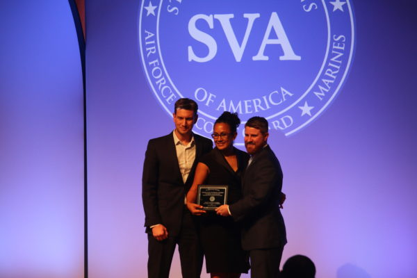 James Petersen and Jennifer Goetz of WUVets accept the Student Veterans of America Chapter of the Year award from SVA President and CEO Jared Lyon