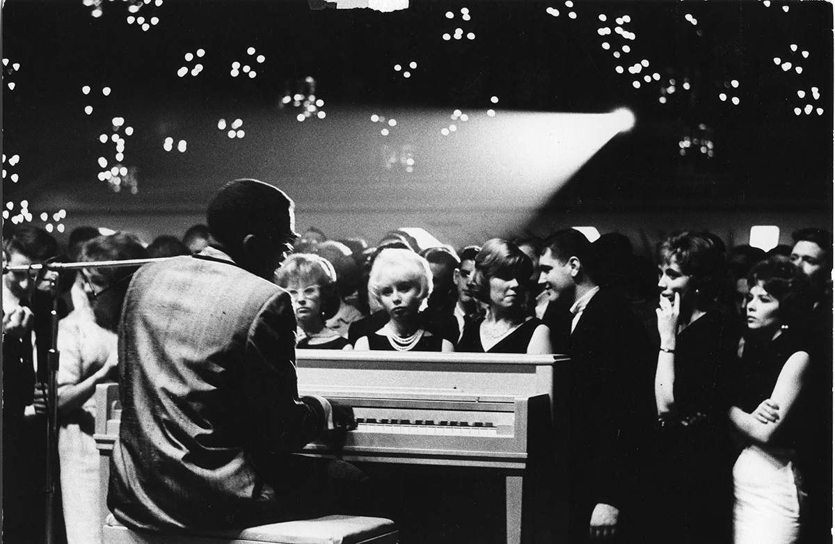Ray Charles plays the piano