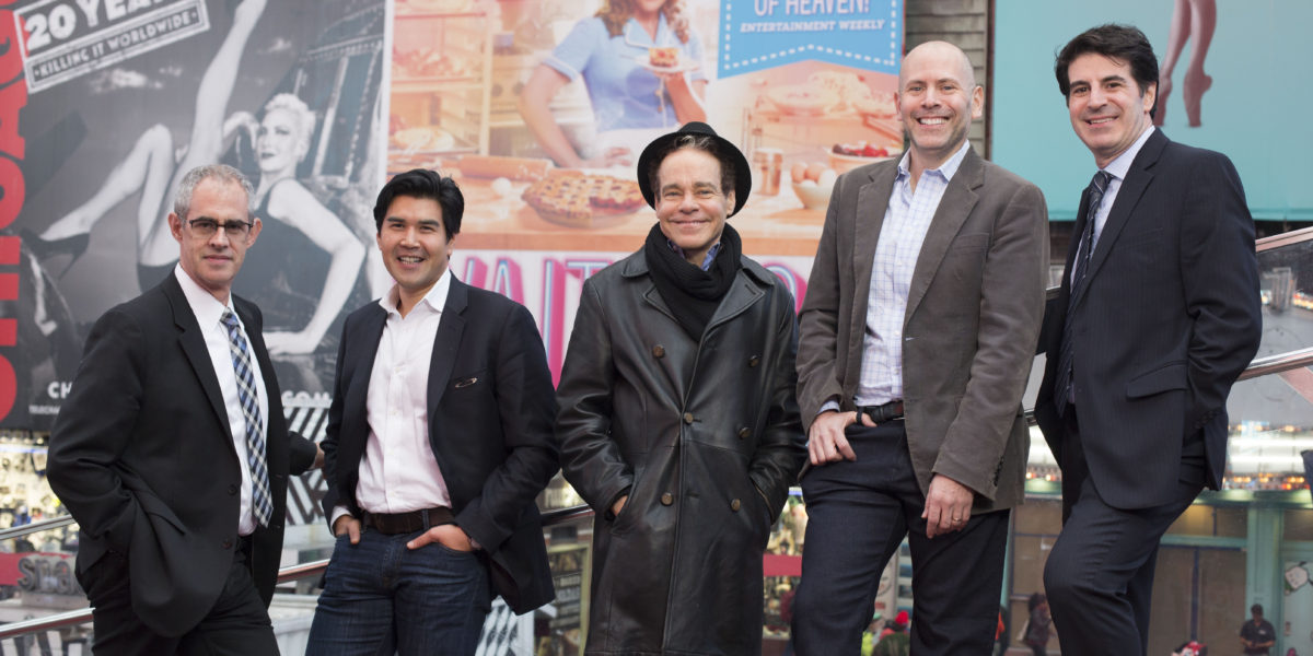 Washington University alumni make an impact on Broadway: (from left) Keith Sherman, Pun Bandhu, Steven Sater, Eric Schnall and Michael Sinder gather in Times Square. (Photo: Jennifer Weisbord, BFA '92)