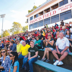 Alumni, students, parents and friends watch the football Bears square off against the Case Western Reserve University Spartans during Fall Festival. (Joe Angeles/Washington University)