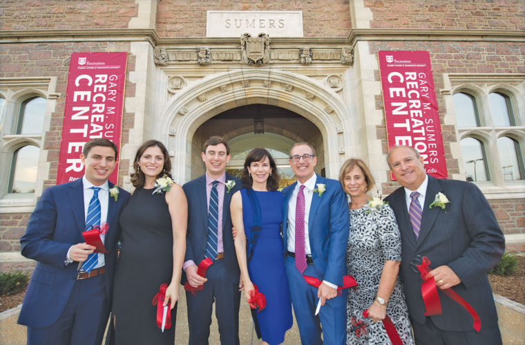 Members of the Sumers family gathered at the dedication of the Gary M. Sumers Recreation Center Oct. 28, 2016: (from left) James Sumers; Katie Sumers; Brian Sumers; Elizabeth Fowler; Gary Sumers, AB '75; Marsha Goldberg; and Stephen Goldberg. (Joe Angeles/Washington University)