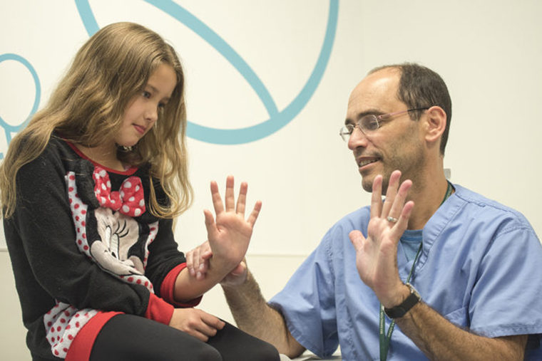 Charles Goldfarb with young patient