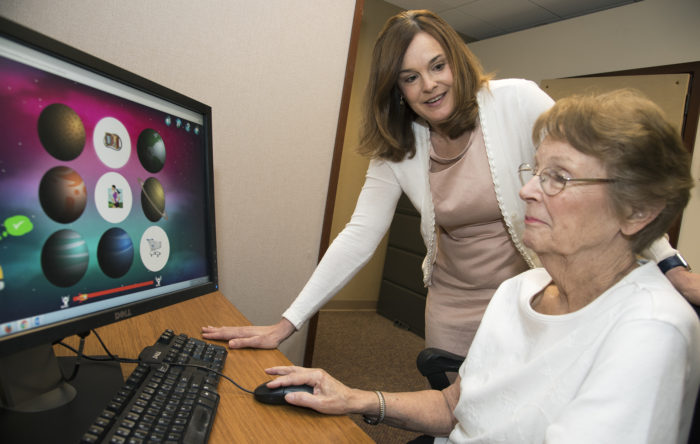 hearing loss patient works at a computer