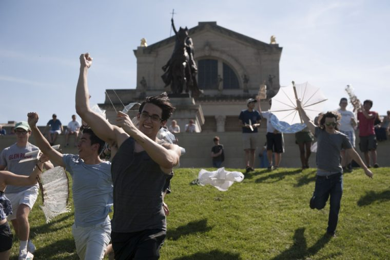 students launch kites on Art Hill