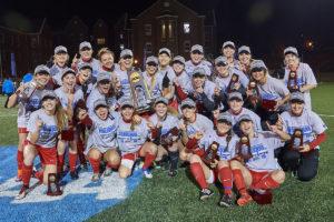 women's soccer team celebrates