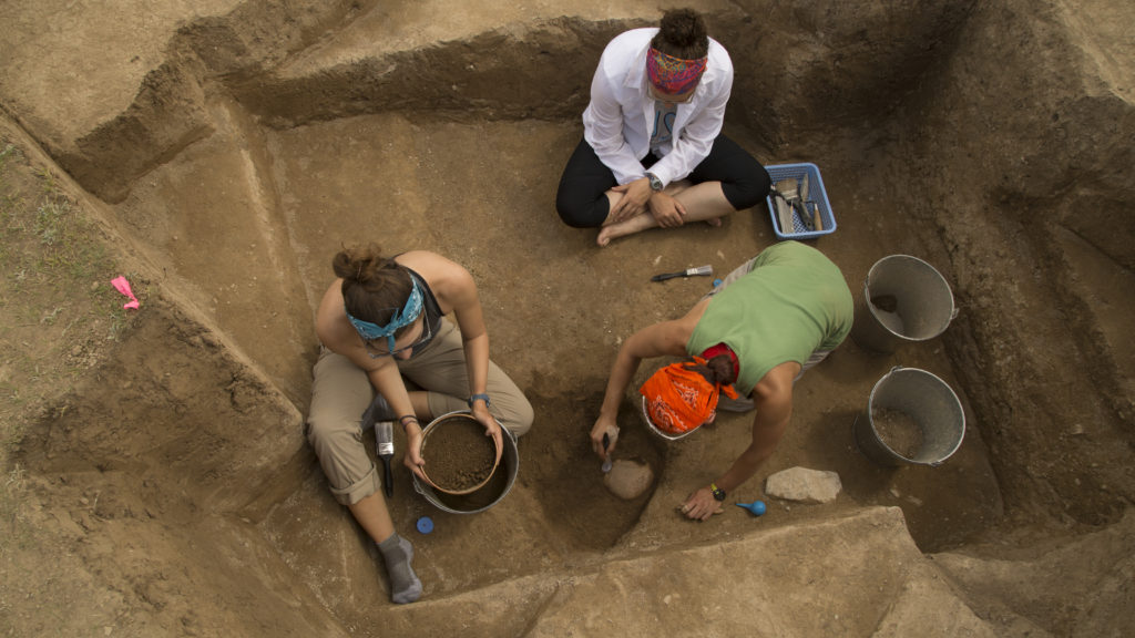 Elissa Bullion (right), MA '14, is in the anthropology doctoral program. She and her team analyze human remains to understand the daily life of the working-class people who lived in Tashbulak. (Photo: Thomas Malkowicz)