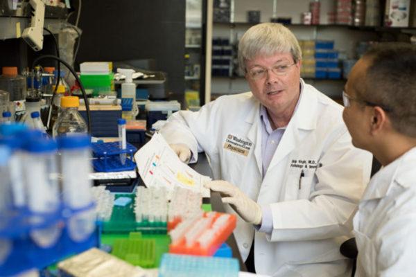 Herbert Virgin speaks with researcher Dale Balce
