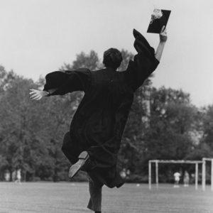A graduate leaps for joy after Commencement 1967. (Washington University Archives)