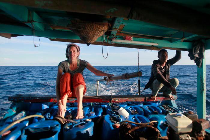 Robin McDowell rides on a boat on the Arafura Sea, off the southeastern coast of Indonesia, where the Thai fishing trawlers were operating. (Courtesy photo)
