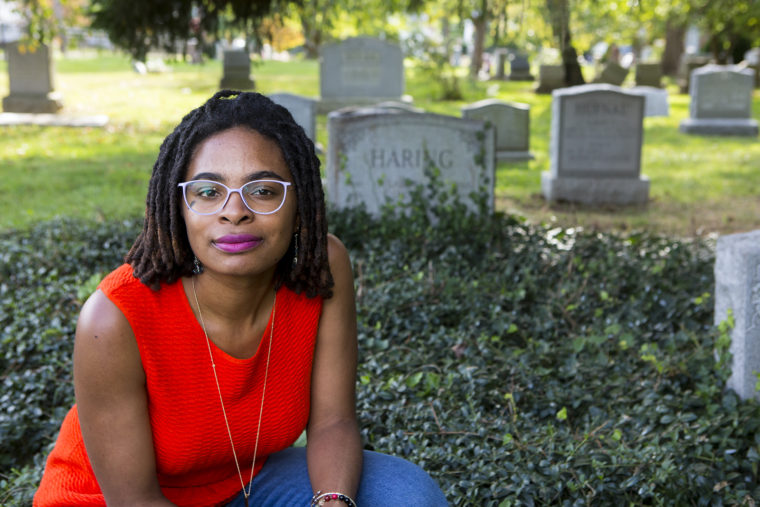 Jamie Thomas in a graveyard.
