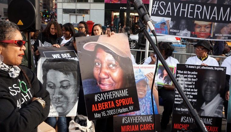 """Say her name"" posters on display May 20, 2015, at a New York City vigil for black women and girls killed by the police. Photo courtesy of All-Nite Images via Wikipedia Commons."