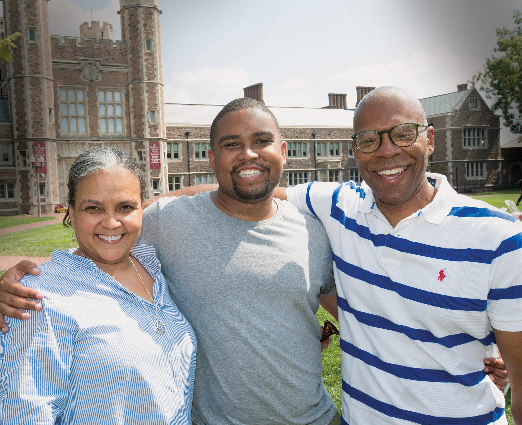 Solomon Brown (center), AB '14, who earned his JD in 2017, attended anniversary events with his mother, Debra Knight Brown, and father, Homer Brown. (Sid Hastings/WUSTL Photo)