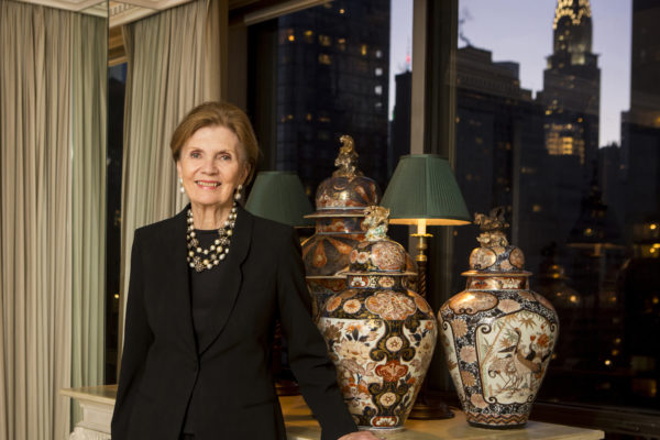 Jane Hardesty Poole is pictured with her collection of 16th- and 17th-century Japanese Imari porcelain in her Manhattan apartment. (Jennifer Weisbord, BFA '92/Washington University)