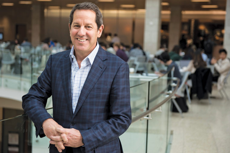 Steven Segal, BSBA '82, a special limited partner of Boston-based private equity investment firm J.W. Childs Associates, as well as a Venture Partner of Cosimo Ventures, is chair of the Alumni Board of Governors (ABG). He is pictured in the atrium of Knight and Bauer Halls before a meeting of the 2017-18 ABG. (Sid Hastings/WUSTL Photos)
