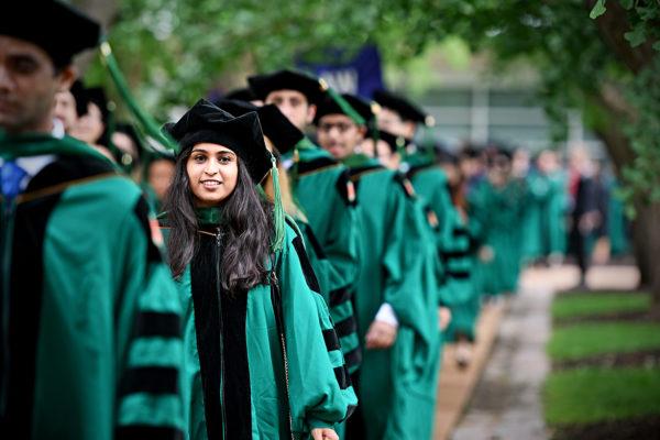 Graduates walking into Quad